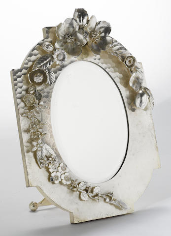 An American Victorian silver-plated easel-back lady's dressing table mirror with applied floral garland Meriden Britannia Co., Meriden, CT, circa 1880's  # 8000