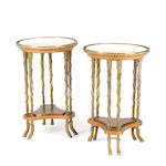A pair of Louis XVI style gilt bronze mounted burlwood, mahogany and marble guéridons<BR /> after Adam Weisweiller<BR />first half 20th century
