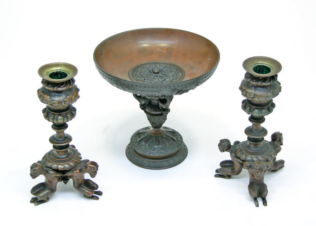 A Renaissance revival patinated bronze tazza and a similar pair of candlesticks late 19th/early 20th century
