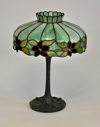 A leaded glass and patinated metal lamp, Attributed to McKenney & Waterbury Company first quarter 20th century