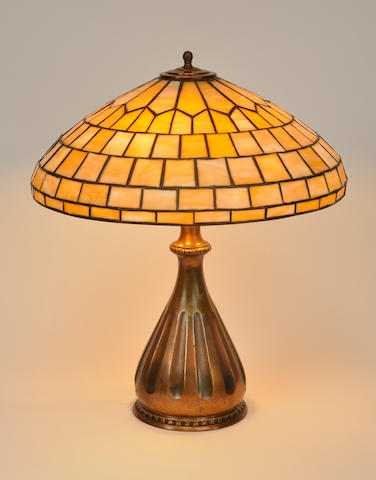 A Duffner and Kimberly and Pairpoint leaded glass and patinated metal Geometric table lamp<BR />first quarter 20th century