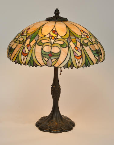 A J.A. Whaley leaded glass and patinated metal table lamp first quarter 20th century
