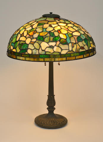 An American leaded glass and patinated-metal table lamp first quarter 20th century