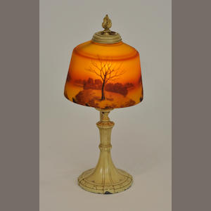 An American reverse-painted glass and painted metal scenic boudoir lamp. first quarter 20th century