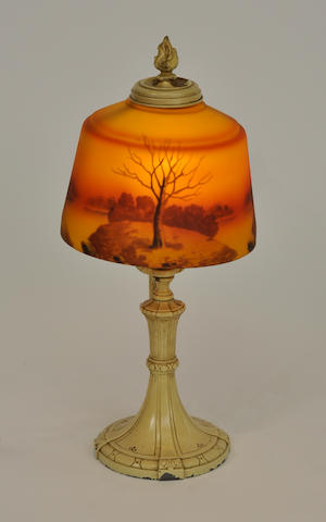 An American reverse-painted glass and painted metal scenic boudoir lamp<BR />first quarter 20th century