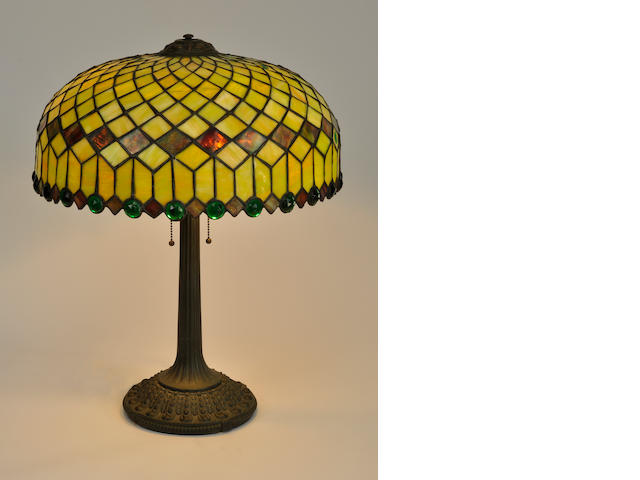 "An American leaded glass and patinated metal ""jeweled"" geometric lamp<BR />Attributed to The Edward Miller Company<BR /> first quarter 20th century"