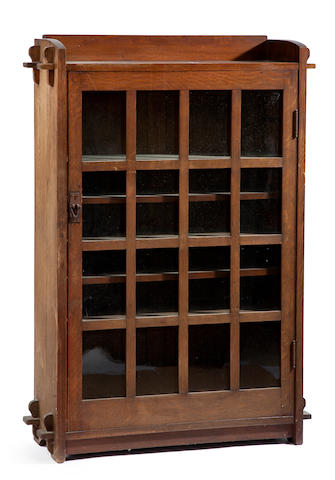 A Gustav Stickley oak single door bookcase circa 1904