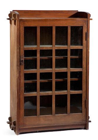 A Gustav Stickley oak single door bookcase circa 1904