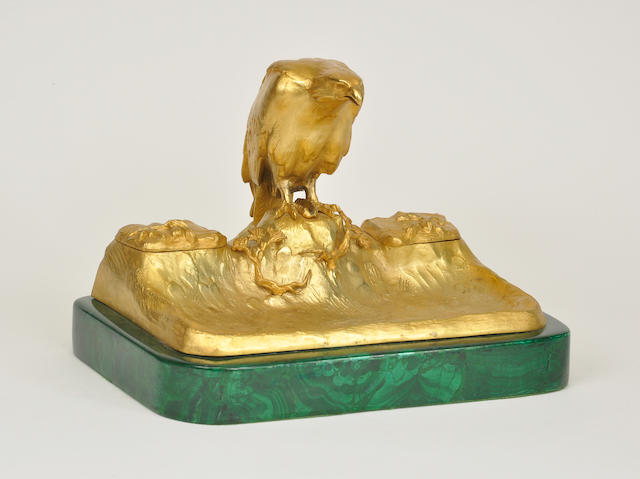 A French gilt bronze and malachite veneered desk stand surmounted by a standing eagle<BR />circa 1900