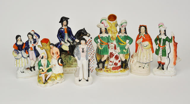 Seven Staffordshire and Staffordshire style Turpin figural groups or spill vases late 19th century and later