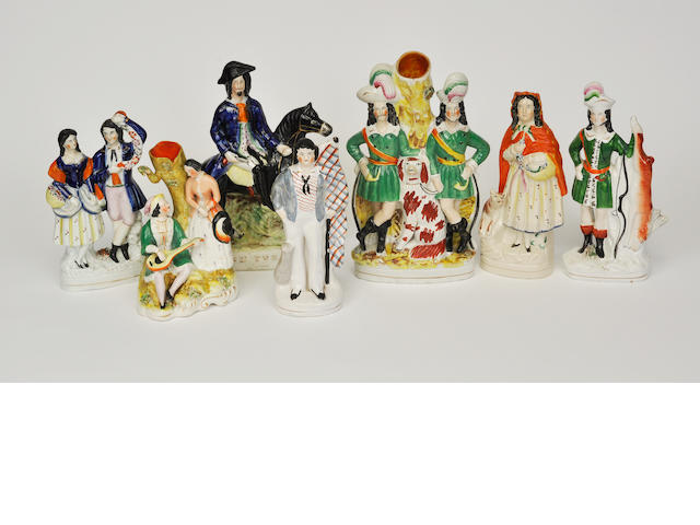 Seven Staffordshire and Staffordshire style figural groups or spill vases<BR />late 19th century and later