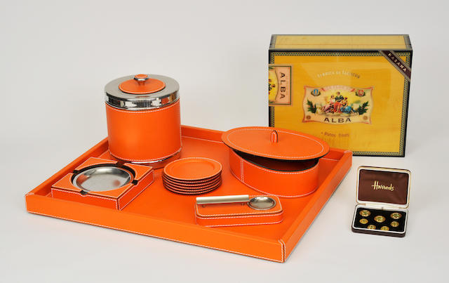 An eleven-piece orange granular leather and chrome mounted smoking set 20th century