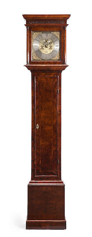 A Queen Anne walnut tall case clock<BR />the dial inscribed Thomas Hutly, Coggeshall<BR />early 18th century