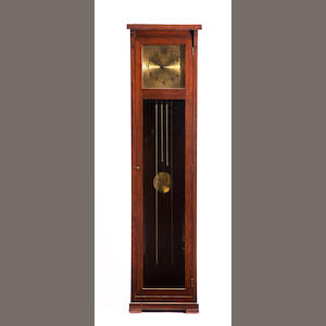 An Arts and Crafts style oak tall case clock. early 20th century