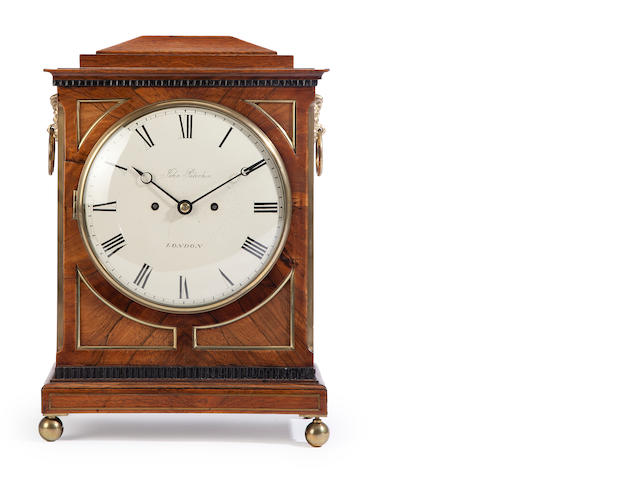 A Regency rosewood and brass bracket clock<BR />the dial inscribed John Peterkin, London<BR />early 19th century