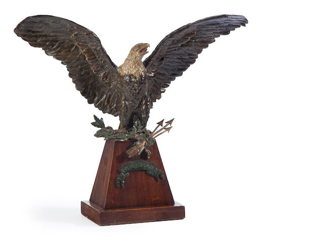 A painted metal figure of a wingspread eagle holding three arrows and a garland<BR />late 19th/early 20th century