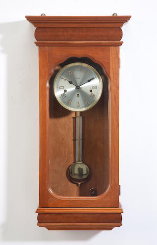A Hentschel cherry and metal wall clock<BR />21st century