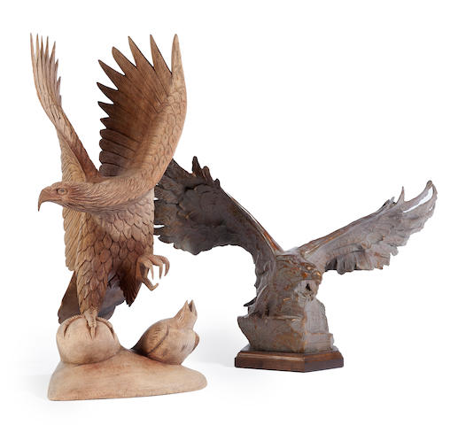 A contemporary patinated metal figure of a wingspread eagle