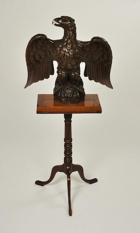 A carved walnut figure of a wingspread eagle on a Federal walnut lectern stand the eagle second half 19th century, the stand early 19th century