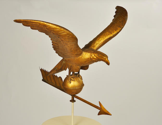 A gilt copper and zinc wingspread eagle and arrow weathervane late 19th/early 20th century