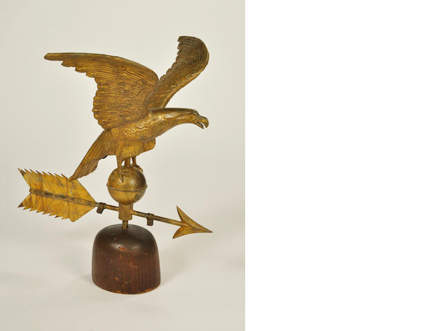 A gilt copper wingspread eagle and arrow weathervane<BR />late 19th century