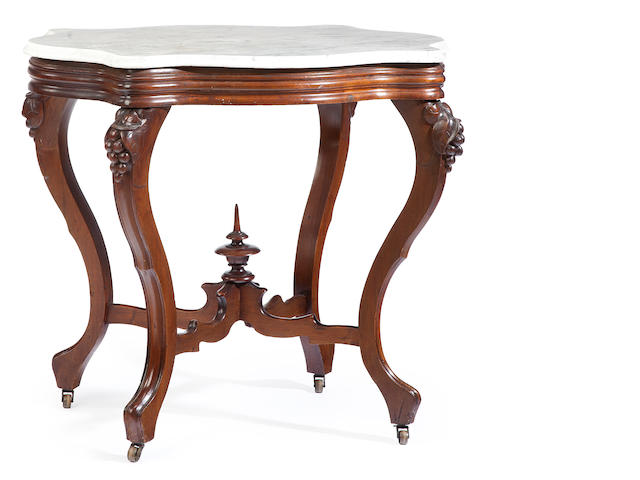 A late Victorian carved walnut and marble top center table<BR />circa 1900