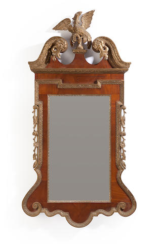 A pair of George II style parcel gilt mahogany and gilt gesso mirrors<BR />late 19th/early 20th century