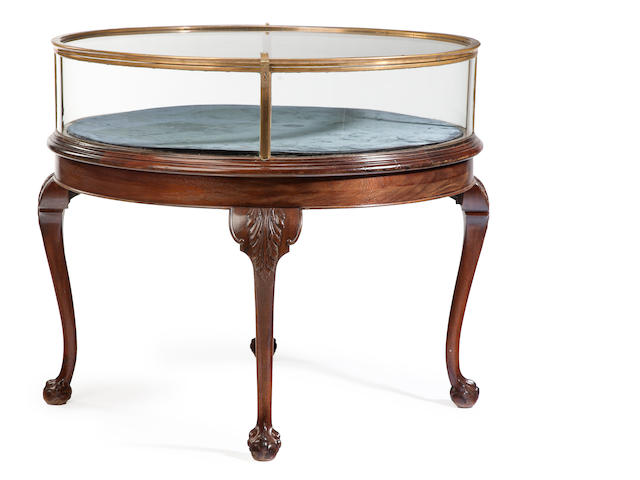 A Chippendale style mahogany and brass circular vitrine cabinet 19th century