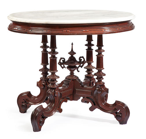 A Victorian rosewood marble top oval center table third quarter 19th century