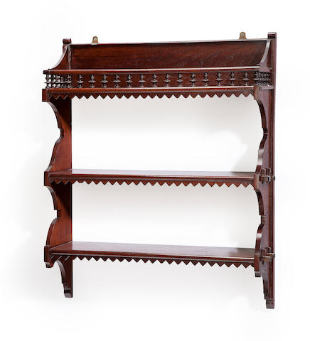 A Victorian Renaissance Revival walnut partially ebonized wall hat rack, together with a Mission style walnut wall shelf