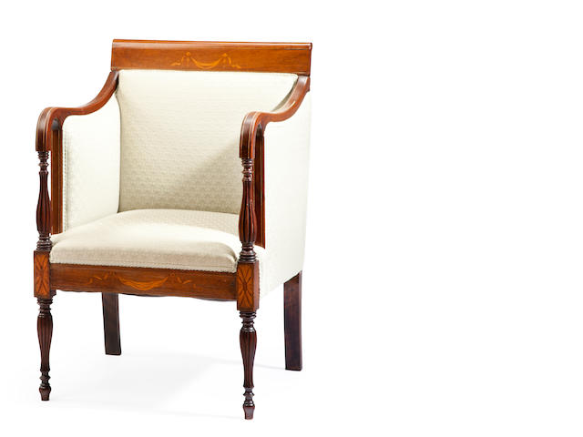A Federal style mahogany inlaid and upholstered lolling chair on reeded legs late 19th/early 20th century