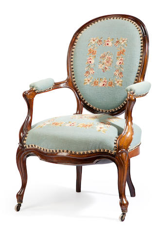 A Victorian Rococo Revival needlepoint armchair 19th century