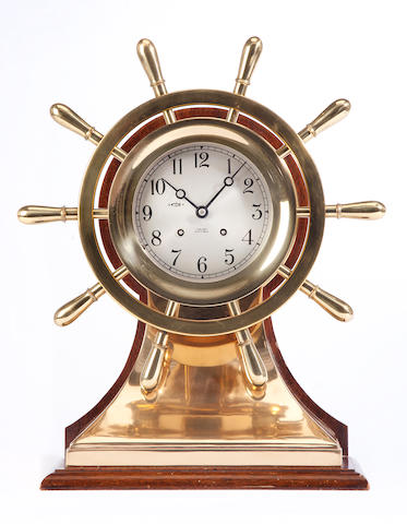 A 5–inch Chelsea ships clock in the form of a ship's wheel