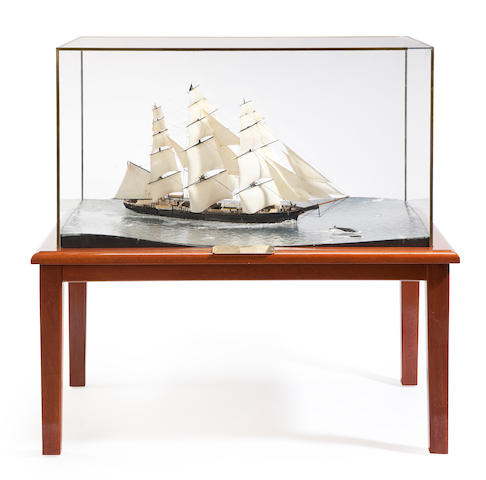 A clear water diorama of the clipper ship Flying Fish By Arthur Clark 36 ½ x 23 x 23in with table