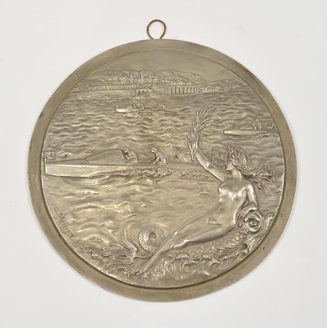 A circular motorboat trophy plaque in nickel, after G. Moret diameter 8 ½in