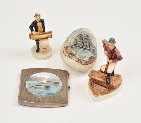 A group of maritime items Including a cigarette box, a painted stone, and two miniature figures.
