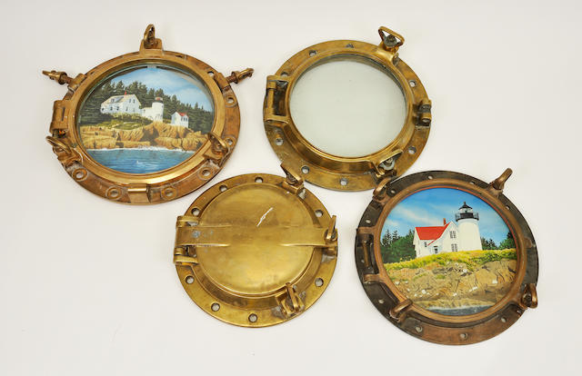 A collection of eleven portholes  early 20th century 21 in. (53.3 cm.) diameter, the largest. 11