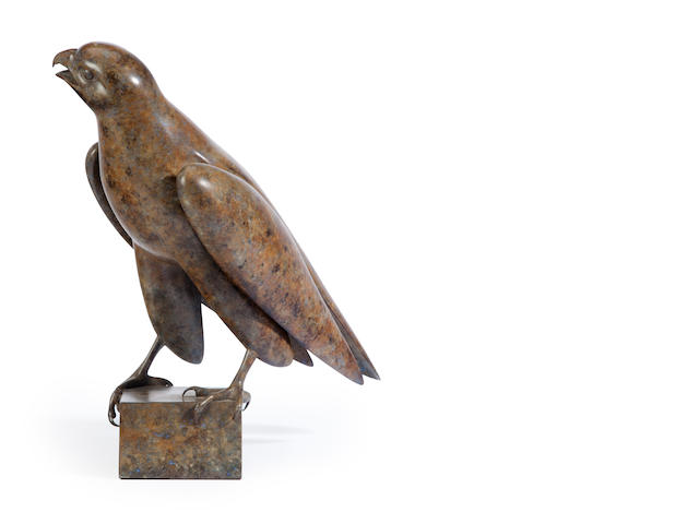A patinated metal sculpture of a falcon<BR />20th century