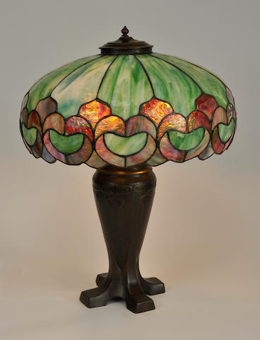 An American leaded glass and patinated metal table lamp<BR />the base Handel<BR />first quarter 20th century