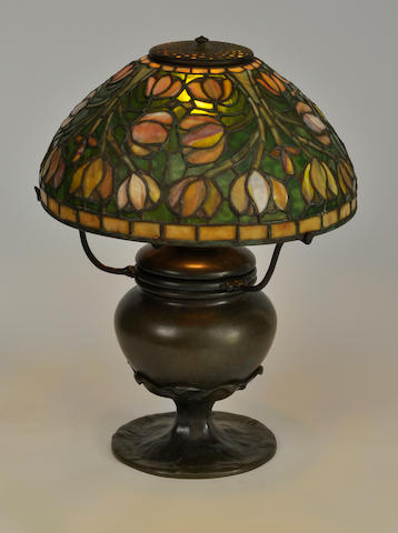 A Tiffany Studios patinated bronze table  lamp base first quarter 20th century