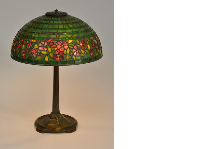 A Tiffany Studios Favrile glass and patinated bronze Wild Rose Border table lamp<BR />first quarter 20th century
