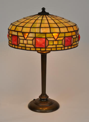 A Wilkinson leaded glass and patinated metal Geometric table lamp<BR />first quarter 20th century