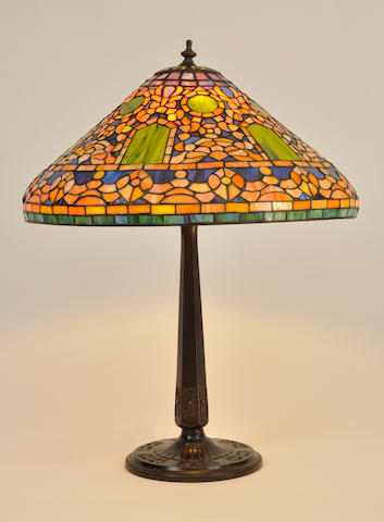A contemporary leaded glass and patinated metal table lamp