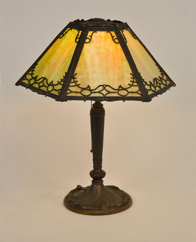 An American slag glass and patinated metal table lamp first quarter 20th century