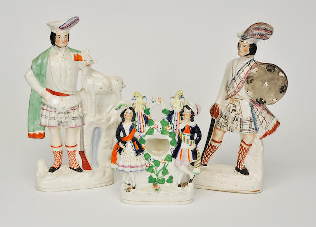 Three Staffordshire Highland dress figures or figural groups late 19th century and later