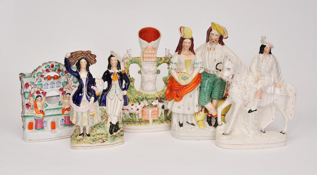 Five Staffordshire and Staffordshire style figural groups<BR />late 19th century and later