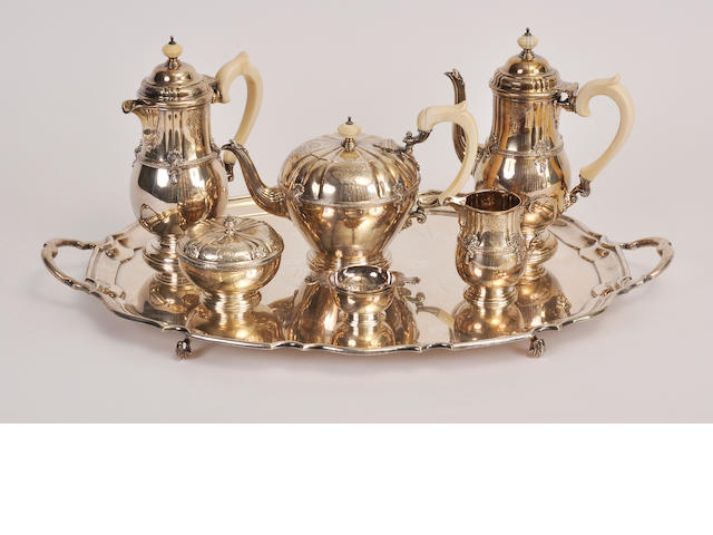 An George V sterling silver six piece tea and coffee service and a similar George V sterling silver two-handled tray