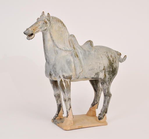 A partially glazed pottery figure of a horse in ancient Chinese style