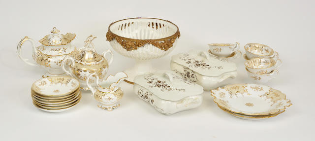 A Staffordshire gilt decorated part dessert service