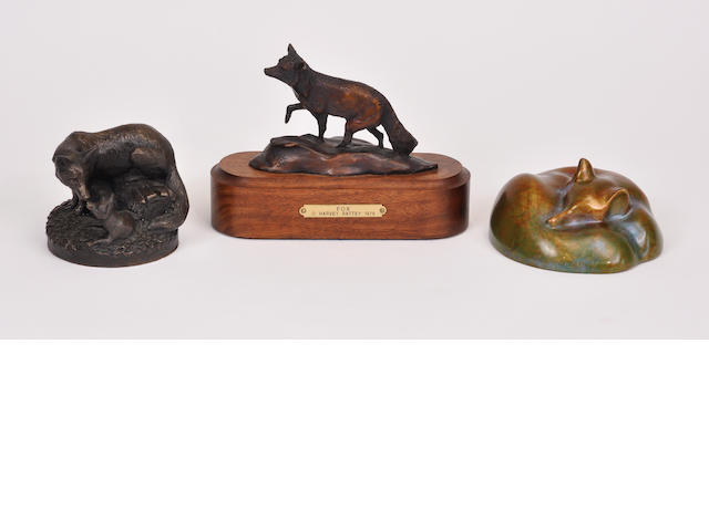 A group of three patinated bronze and patinated plaster sculptures of foxes<BR />20th century